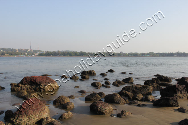 Rocks at Coco beach with Mandovi river behind