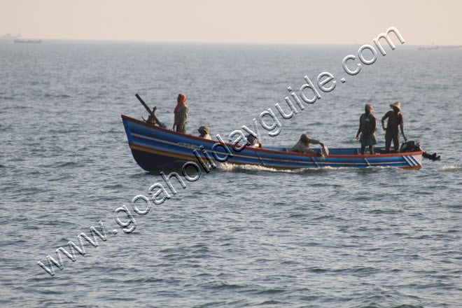 Fishing boat returning with its catch at Polem beach